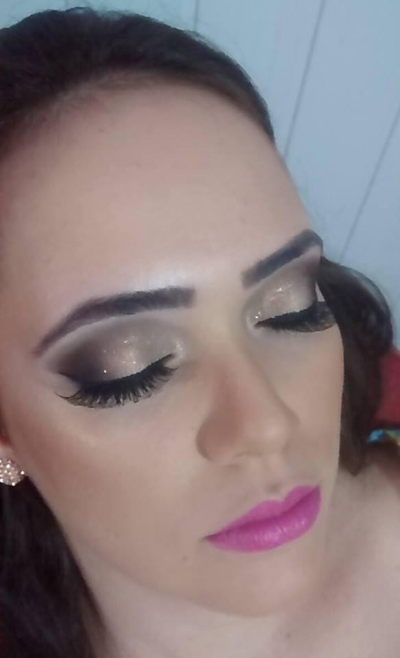 Maquiagem dourada maquiador(a)