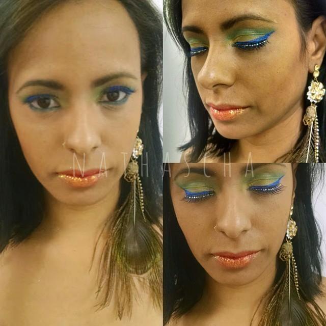 Make cores do Brasil  Pele preparada,olhos com cores da bandeira brasileira, com cílios com pedraria e o maior destaque a boca laranja com glitter. carnaval, artística, cores do Brasil maquiagem  maquiador(a) designer de sobrancelhas